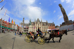 Horse-drawn carriage with tourists in Grote Market. Stock Photo