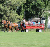 Horse drawn carriage/wagon  with people Stock Photo