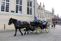 Horse-drawn carriages in Bruges, Belgium Royalty Free Stock Photos