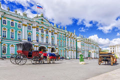 Horse-drawn carriages on the Palace Square in St. Petersburg Stock Photography