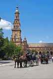 Horse drawn carriages in the Plaza de Espana. Royalty Free Stock Photo