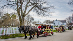 Horse drawn carriages transport passengers on Mackinac Island Stock Photo