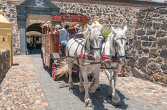 Horse drawn coach leaving Castle of Good Hope Stock Photos