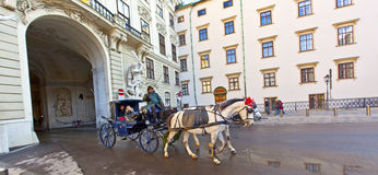Horse drawn fiaker at the Hofburg Stock Photos