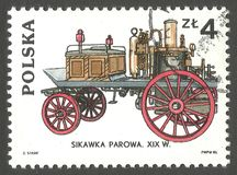Horse drawn fire pump. Poland - stamp 1985, Issue Fire brigades , Series Fire Engines Classic And Contemporary, Horse drawn fire pump 19th century Royalty Free Stock Photo