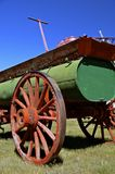 Horse drawn fire pumper. Vintage fire pumper water barrel on a trailer with large wooden wheels is pulled by horses Stock Photography