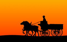 Horse-drawn Wagon Silhouette. Silhoutte of a horse-drawn wagon at sunset (inculdes clipping path for the outline of the horses/wagon Royalty Free Stock Photos