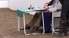 Horse dressage competition judges and rider stock video