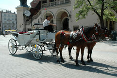 Horse driven carriage in Krakow, Poland Stock Photography