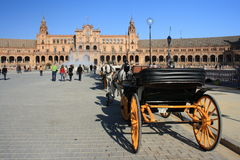 Horse-driven carriage with tourists at Plaza de Espana Royalty Free Stock Image