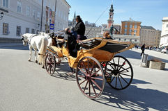 Horse driven carriage with tourists, Salzburg Stock Photo