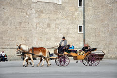 Horse driven carriage with tourists, Salzburg Stock Photos