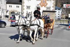 Horse driven carriage with tourists in Salzburg Stock Photo