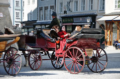 Horse driven carriage with tourists in Salzburg Royalty Free Stock Image