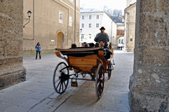 Horse driven carriage with tourists in Salzburg Royalty Free Stock Images