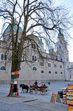 Horse driven carriage with tourists in Salzburg Stock Photos