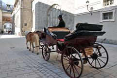 Horse driven carriage with tourists in Salzburg Royalty Free Stock Photo