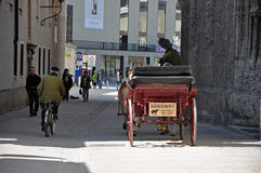 Horse driven carriage with tourists in Salzburg Stock Image