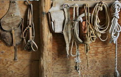 Horse Equipment. Saddle and tack equipment hanging in the barn royalty free stock photos