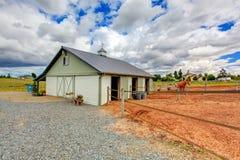 Horse farm land with barn. Stock Photos