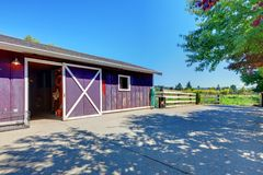 Horse farm shed in purple on American farm. Royalty Free Stock Photo
