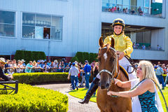 Horse and female Jockey getting ready for the race at Emerald Downs Royalty Free Stock Photography