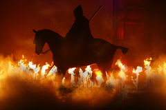 Horse and fire. Horse silouette in a fire act for a medieval demostration Royalty Free Stock Photo