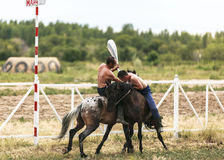 Horse game in Kyrgyzstan. This photo was taken in Kyrgyzstan. The Central Asian country of Kyrgyzstan offers many possibilities for excellent horse riding stock image