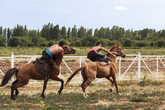 Horse game at Song Kul Lake in Kyrgyzstan Stock Images