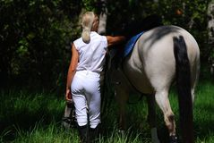 Horse girl. Girl and horse share quiet moment at gymkana Stock Photos
