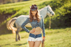 Horse and girl with cowboy hat Stock Photos