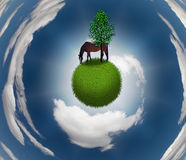 Horse on Grassy Sphere. With tree Royalty Free Stock Images