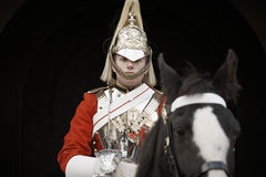 Horse Guard. Member of the Royal Horse Guards in traditional body armor with helmet on sentry in front of the palace Horse Guard in October 27, 2012 in London stock photography