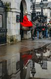 Horse Guard outside the Household Cavalry Division in Whitehall surrounded by tourists on a cold day. London, UK - March 7th, 2018: Horse Guard outside the royalty free stock photos