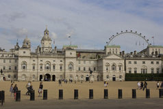 Horse Guard's Palace in London. LONDON, UNITED KINGDOM - SEPTEMBER 11 2015: Horse Guard's Palace in London with the Millennium Wheel in the background Stock Photo