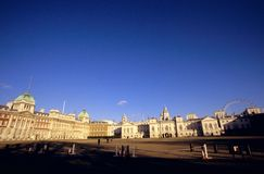 Horse Guards & the London Eye. The Horse Guards Parade ground with the Old Admiralty building on the left, the Horse Guards building in the centre right and the Royalty Free Stock Photos