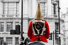 Horse guards parade in London, England. A Royal Horse Guards soldier in traditional uniform sitting on horseback during horse guards parade in London, England Stock Images