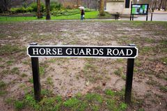 Horse Guards Road street sign with St James Park in the background, London, UK, 2018. Horse Guards Road - Road Signage withSt James Park in the background on a Stock Photos