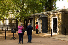 Horse Guards and Tourists. LONDON, UK - 26TH SEPTEMBER 2014: People taking photographs of a Horse Guardsman stock photo
