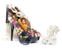 Horse harnessed to trolley - a shoe with a doll Stock Images