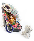 Horse harnessed to trolley - a shoe with a doll Stock Photo