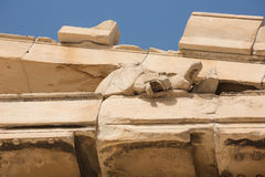 Horse head coming out of the pediment. Of the Parthenon on the Acropolis Hill Stock Image