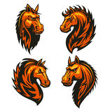 Horse head in fire shape heraldic icons. Horse head in fire shape with thorny prickly mane. Stylized heraldic emblems of furious flaming stallion for sport club Stock Photography