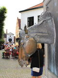 Horse head sculpture Bruges street Belgium Stock Images