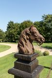 Horse head sculpture in the picturesque Jardins du Manoir d Eyrignac in Dordogne. royalty free stock photography