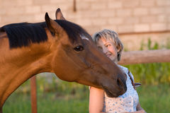 Horse head on womans shoulder Royalty Free Stock Photos