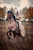 Horse-hunting with ladies in riding habit Royalty Free Stock Image