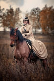 Horse-hunting with ladies in riding habit Royalty Free Stock Photography
