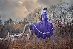 Horse-hunting with ladies in riding habit. Costumes. Historical reconstruction of famous XIXth century russian hounds hunting by horse club Avanpost Stock Photo