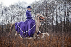 Horse-hunting with ladies in riding habit stock images